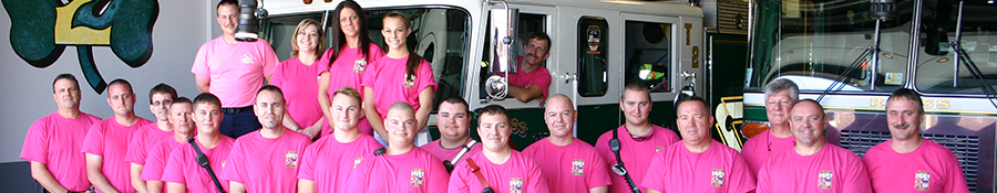 Firefighters wearing pink shirts for breast cancer awareness month