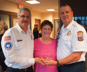 Chief Allen Baldwin accepting DSS Community Partner Award